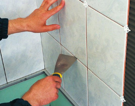 laying tiles in the bathroom